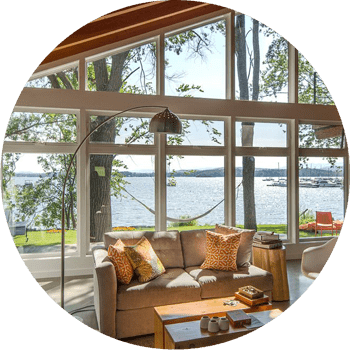 Lake-view-living-room-contemporary-with-french-doors-eames-metal-eiffel-base